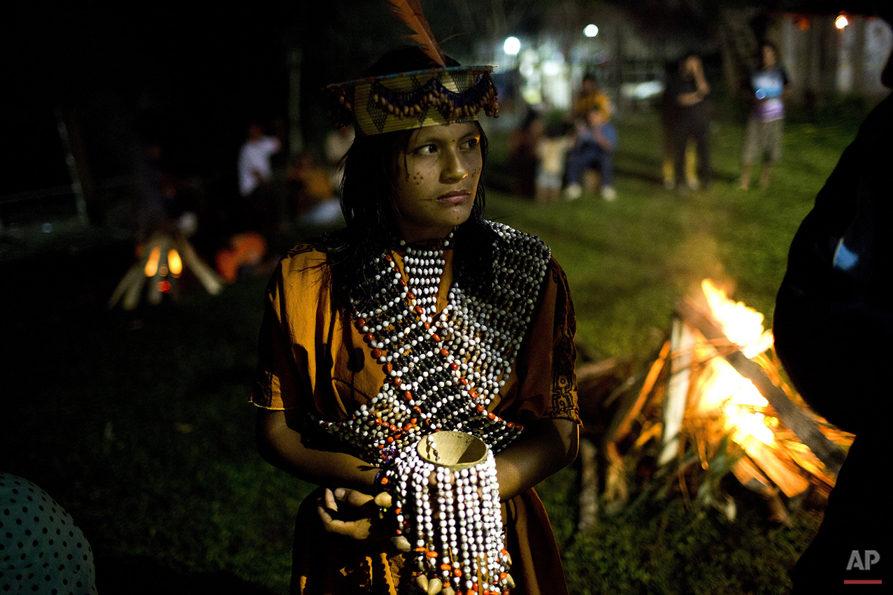 "In this June 23, 2015 photo, Ashaninka Indian Beysi Anaya, 17, representing her village Sampantuari, waits to perform in the annual beauty contest, in Otari Nativo, Pichari, Peru. Sampantuari, translates from the Ashaninka language as, ""fallen leaves that form shadows on the water."" Beysi was crowned winner of the beauty contest. (AP Photo/Rodrigo Abd)"