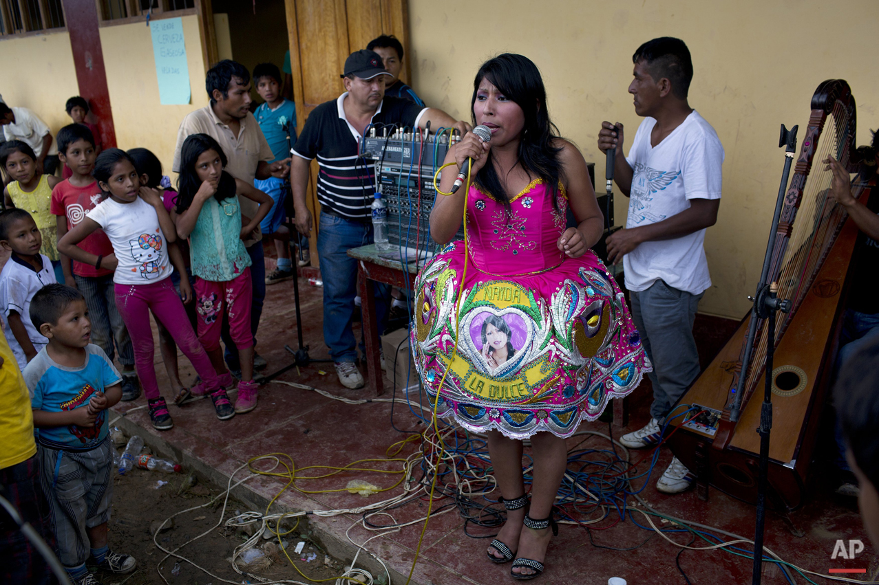 In this March 15, 2015 photo, Nanda la Dulce performs Huayno music during a soccer tournament between villages, in La Mar, province of Ayacucho, Peru. (AP Photo/Rodrigo Abd)