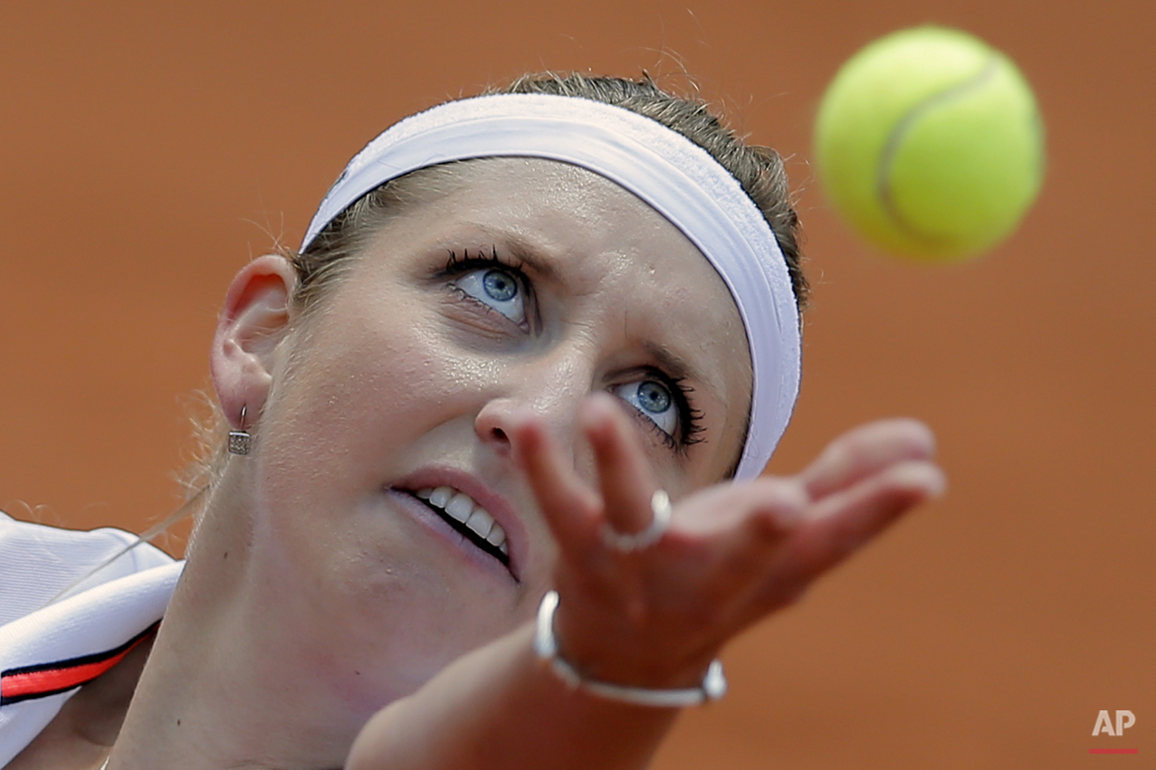 Timea Bacsinszky of Switzerland serves in the third round match of the French Open tennis tournament against Madison Keys of the U.S. at the Roland Garros stadium, in Paris, France, Saturday, May 30, 2015. Bacsinszky won in two sets 6-4, 6-2. (AP Photo/Christophe Ena)