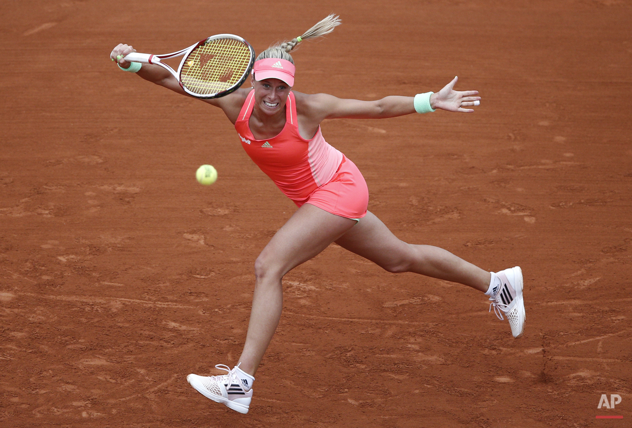 Andrea Hlavackova of the Czech Republic returns the ball to Serena Williams of the U.S. during their first round match of the French Open tennis tournament at the Roland Garros stadium, Tuesday, May 26, 2015 in Paris. (AP Photo/Christophe Ena)