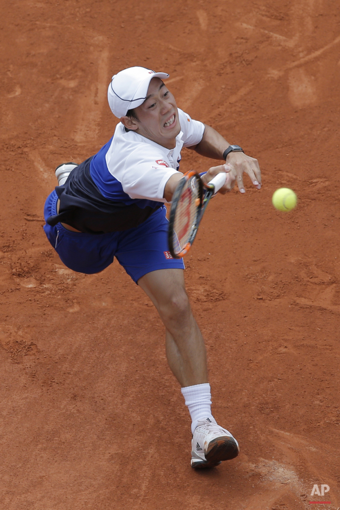 Japan's Kei Nishikori returns in the first round match of the French Open tennis tournament against Paul-Henri Mathieu of France at the Roland Garros stadium, in Paris, France, Sunday, May 24, 2015. (AP Photo/Christophe Ena)