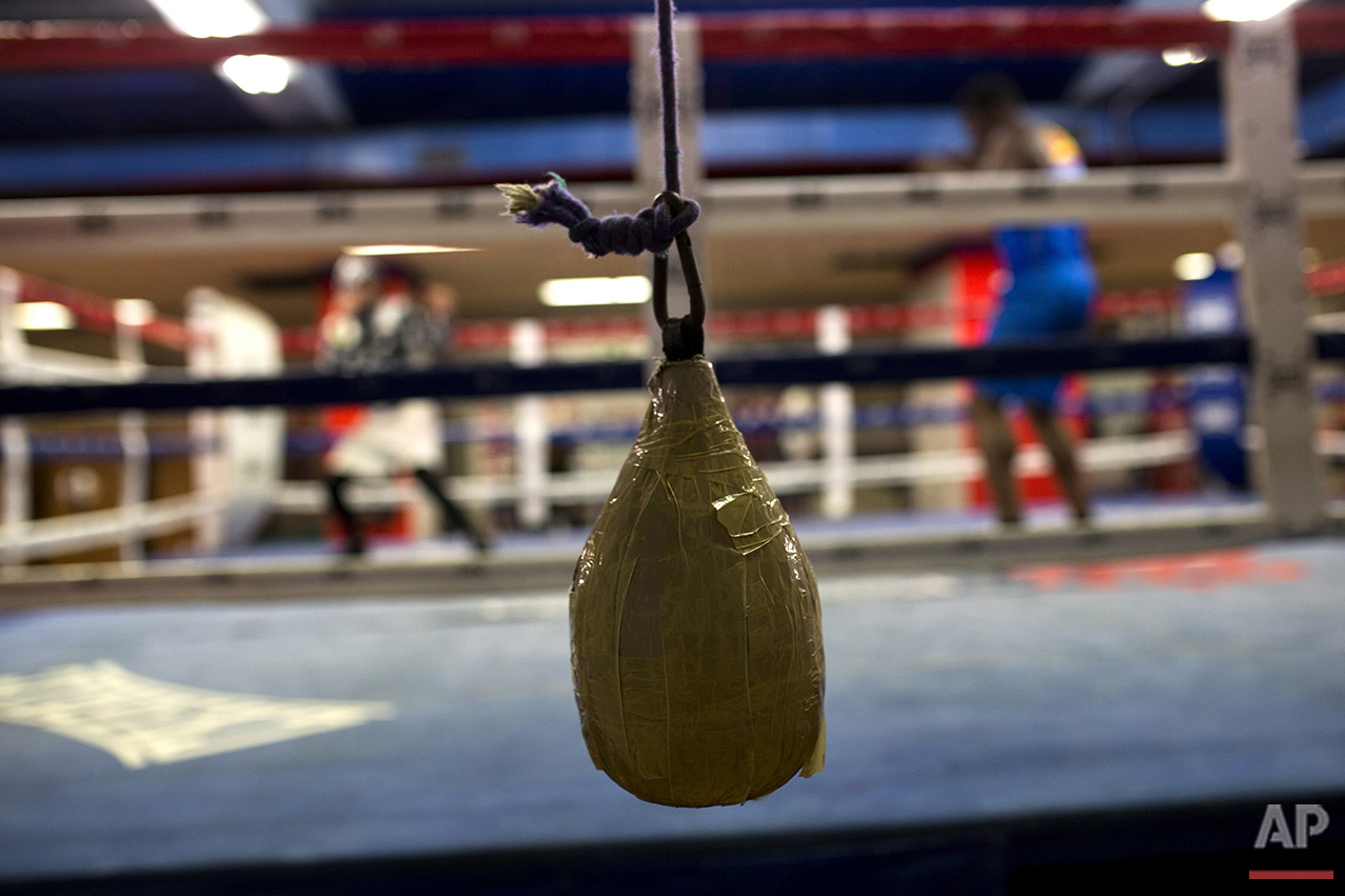 In this Wednesday, April 20, 2016 photo, boxers work out inside a ring during a training session at El Rayo boxing gym in Madrid. (AP Photo/Francisco Seco)