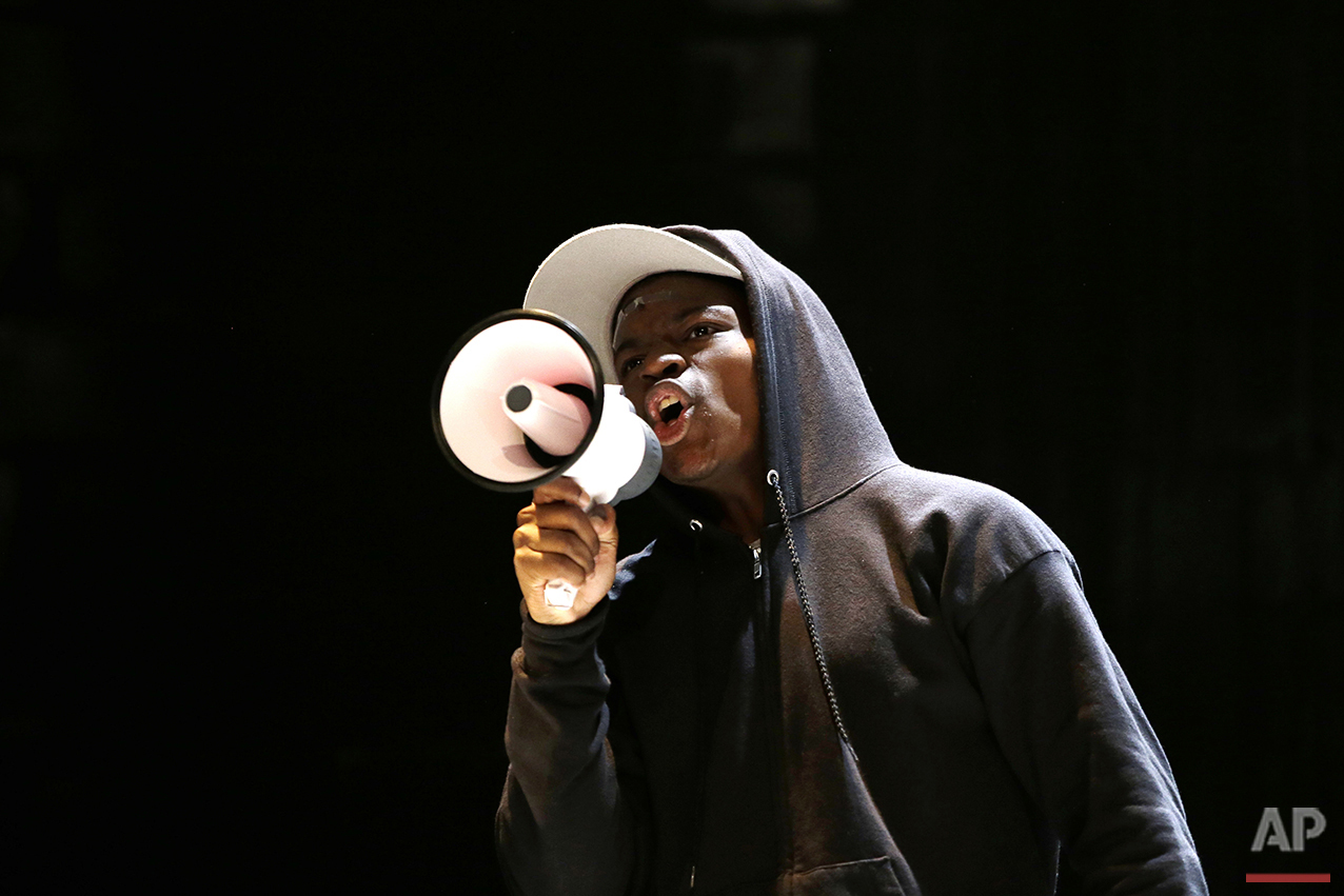 In this Tuesday, May 10, 2016, photo, actor Amir Randall, playing Trayvon Martin, acts out a scene during a rehearsal for The Ballad of Trayvon Martin at the New Freedom Theatre in Philadelphia. The play, about the death of 17-year-old Trayvon Martin, opens Thursday. (AP Photo/Matt Slocum)