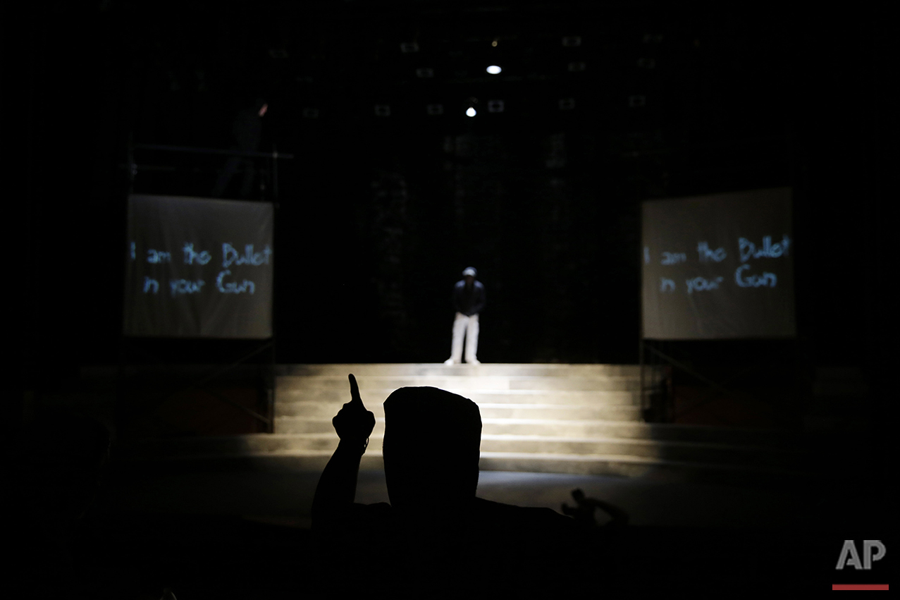 In this Tuesday, May 10, 2016, photo, director Rajendra Ramoon Maharaj leads a rehearsal for The Ballad of Trayvon Martin at the New Freedom Theatre in Philadelphia. The play, about the death of 17-year-old Trayvon Martin, opens Thursday. (AP Photo/Matt Slocum)