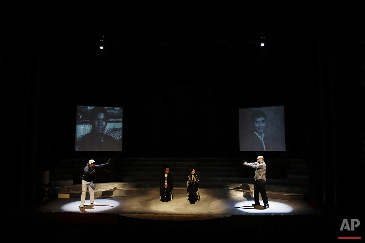 In this Tuesday, May 10, 2016, photo, cast members Amir Randall, from left, Angel Brice, Donna Cherry and Christopher David Roche rehearse a scene for The Ballad of Trayvon Martin at the New Freedom Theatre in Philadelphia. The play, about the death of 17-year-old Trayvon Martin, opens Thursday. (AP Photo/Matt Slocum)