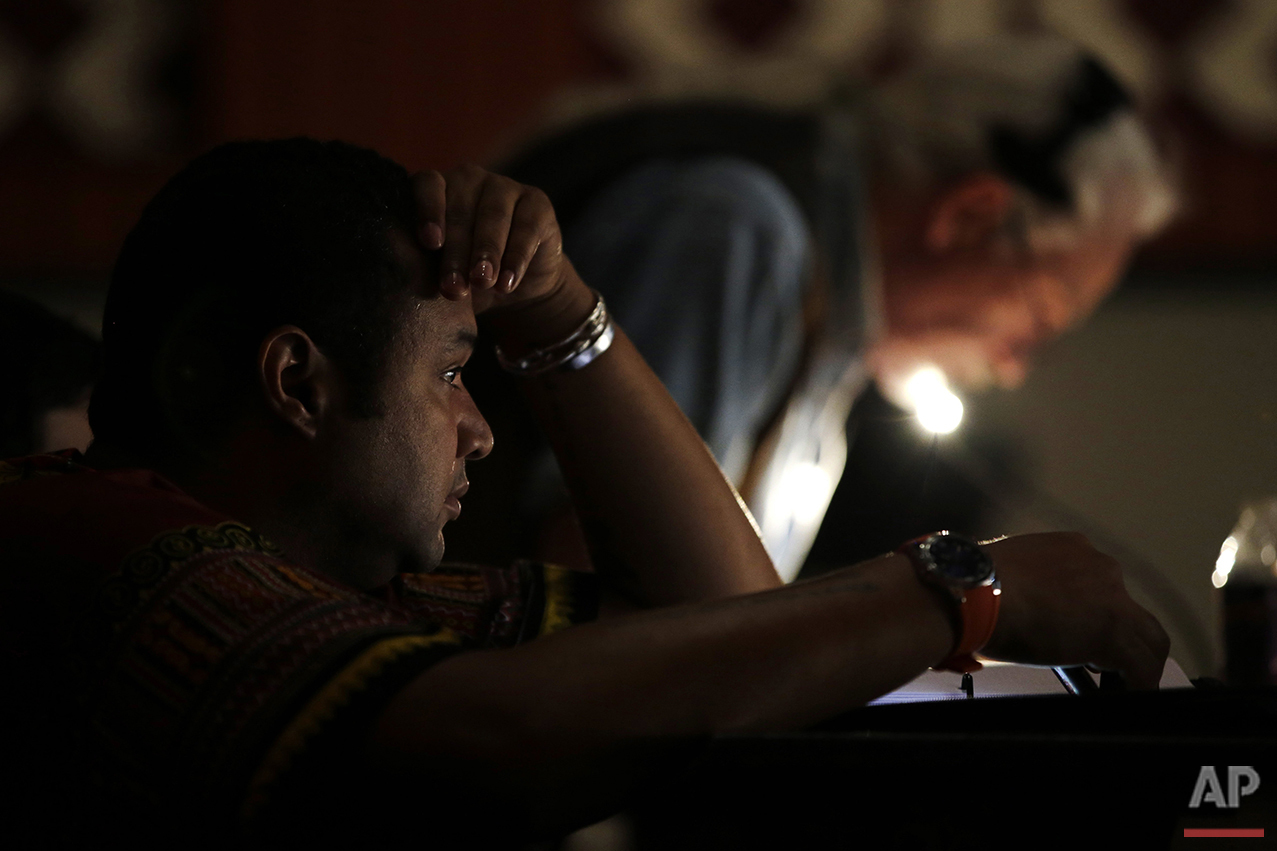 In this Tuesday, May 10, 2016, photo, director Rajendra Ramoon Maharaj, left, watches a rehearsal for The Ballad of Trayvon Martin at the New Freedom Theatre in Philadelphia. The play, about the death of 17-year-old Trayvon Martin, opens Thursday. (AP Photo/Matt Slocum)