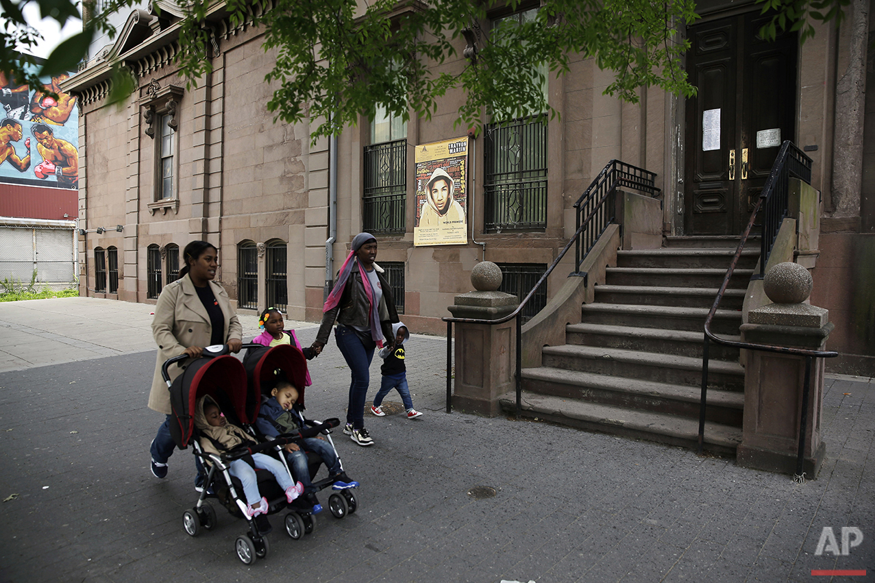 In this Tuesday, May 10, 2016, photo, people walk past the New Freedom Theatre in Philadelphia. The Ballad of Trayvon Martin, a play about the death of the 17-year-old, opens Thursday at the theater. (AP Photo/Matt Slocum)