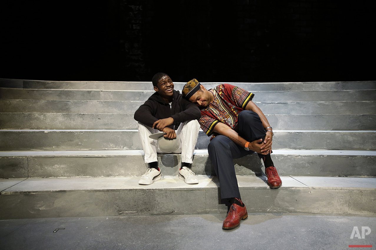 In this Tuesday, May 10, 2016, photo, director Rajendra Ramoon Maharaj, right, leans on actor Amir Randall, who plays Trayvon Martin, after a rehearsal for The Ballad of Trayvon Martin at the New Freedom Theatre in Philadelphia. The play, about the death of 17-year-old Trayvon Martin, opens Thursday. (AP Photo/Matt Slocum)