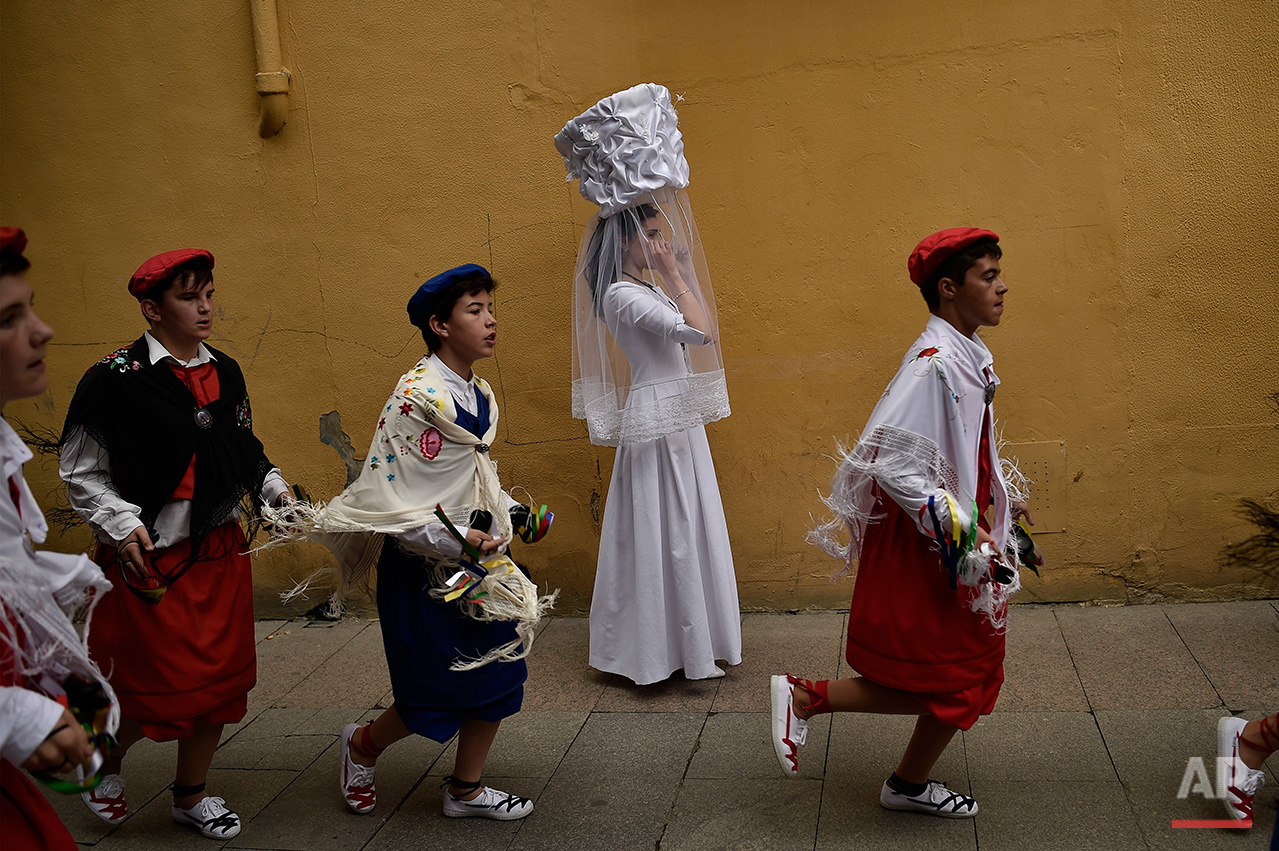 A participant of  ''Bread Procession of the Saint'', takes part in the ceremony in honor of Domingo de La Calzada Saint (1019-1109) who helped poor people and pilgrimage, in Santo Domingo de La Calzada, northern Spain, Wednesday, May 11, 2016.  Every year during spring season, ''Las Doncellas'' (White Virgins), hold on their head a basket cover with white cloth while they walk past along of this old village in honor of the saint. (AP Photo/Alvaro Barrientos)