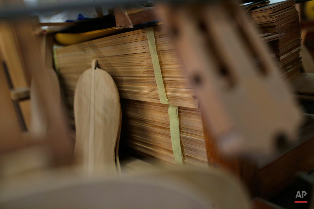 In this Tuesday, Nov. 17, 2015 photo pieces of wood to make 'flamenco' guitars are piled in a workshop in Madrid. Spanish flamenco guitars are known for their beautiful shape, rich wood colors and full-bodied, crisp musical tones. (AP Photo/Francisco Seco)