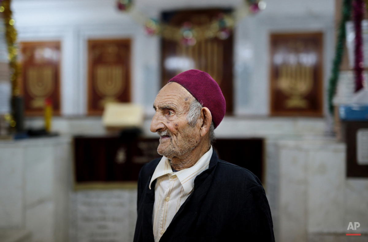 In this Thursday, Oct. 29, 2015 photo, a caretaker of the Synagogue of the Kohanim of Djirt, pauses before prayers, at Hara Kbira, the main Jewish neighborhood on the Island of Djerba, southern Tunisia. The Jewish community in the resort island of Djerba traces its roots all the way back to Babylonian exile of 586 B.C., and is one of the few communities of its kind to have survived the turmoil around the creation of Israel, when more than 800,000 Jews across the Arab world either emigrated or were driven from their homes. (AP Photo/Mosa'ab Elshamy)