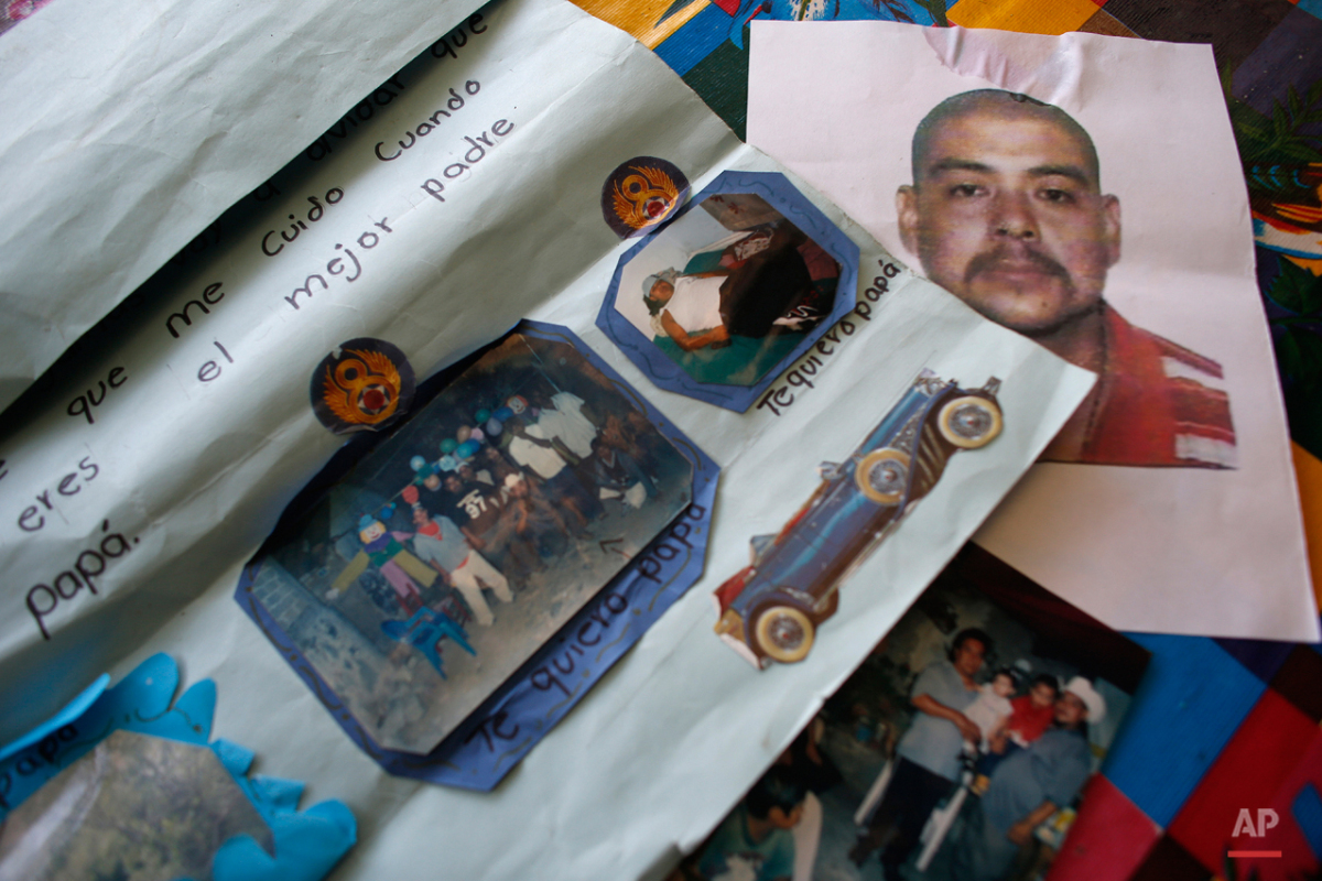 This Oct. 2, 2015 photo show images of Armando De la Cruz Salinas, some pasted onto a Father's Day poster, at his home in Teloloapan, Mexico. The only thing de la Cruz wanted on April 2, 2013, was to take his cousin, Carlos Sanchez, to the hospital so heíd be saved after he was shot outside his home. On the road to the hospital in Iguala, de la Cruz was temporarily blinded as a Guerrero state police truck aimed its spotlight on them from the highwayís shoulder. This was the last time De la Cruz was seen. Sanchez's body was found in an unmarked grave in the mountains outside Iguala in December 2014. (AP Photo/Dario Lopez-Mills)