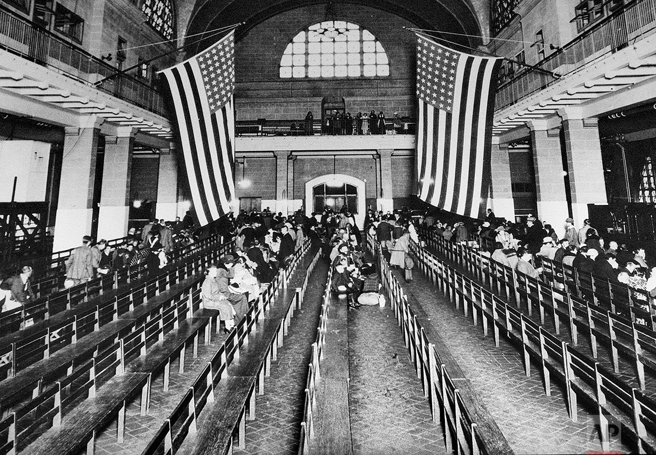 This 1924 photo shows the registry room at Ellis Island in New York harbor, a gateway to America for millions of immigrants. The American self-image is forever intertwined with the melting pot _ a nation that embraces the world's wretched refuse, a nation built by immigrants. But America's immigration history is complicated. (AP Photo)