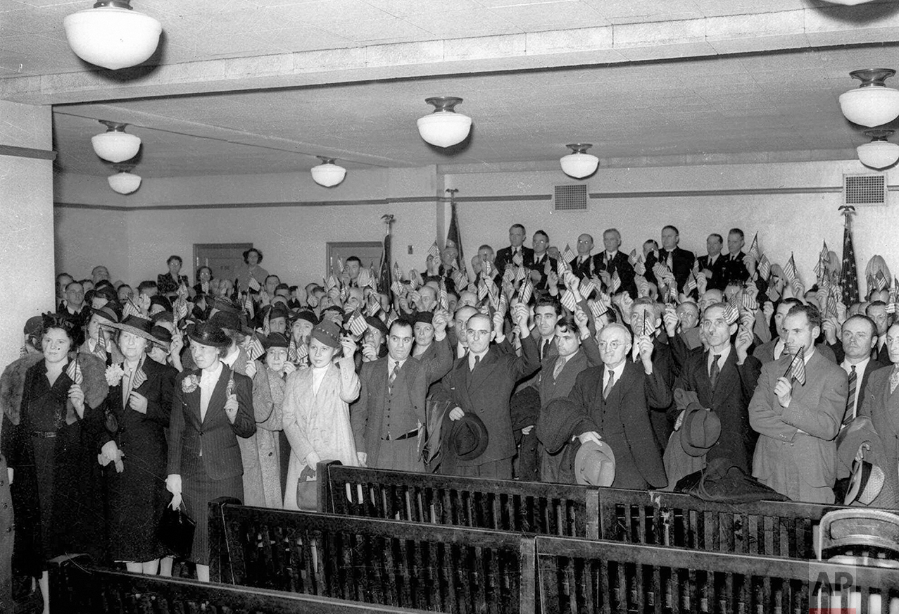 In this April 12, 1939 photo, 126 new citizens of the United States are sworn in at the U.S. District Court in Philadelphia. The United States is far less inviting than it once was: The number of immigrants obtaining legal permanent resident status in 2010 was just over a million _ almost precisely the same number as it was a hundred years earlier, when the population was less than a third of what it is in 2017. (AP Photo)