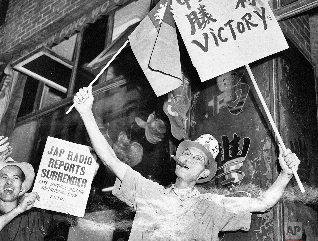 In this Aug. 14, 1945 photo, Chinese-Americans on Mott and Pell Streets in New York's Chinatown celebrate the Japanese surrender on V-J Day. In 1868, the U.S. signed a treaty encouraging Chinese migration; 24 years later, the Chinese Exclusion Act turned away immigrants from what was even then the world's most populous nation. (AP Photo/Tom Fitzsimmons)