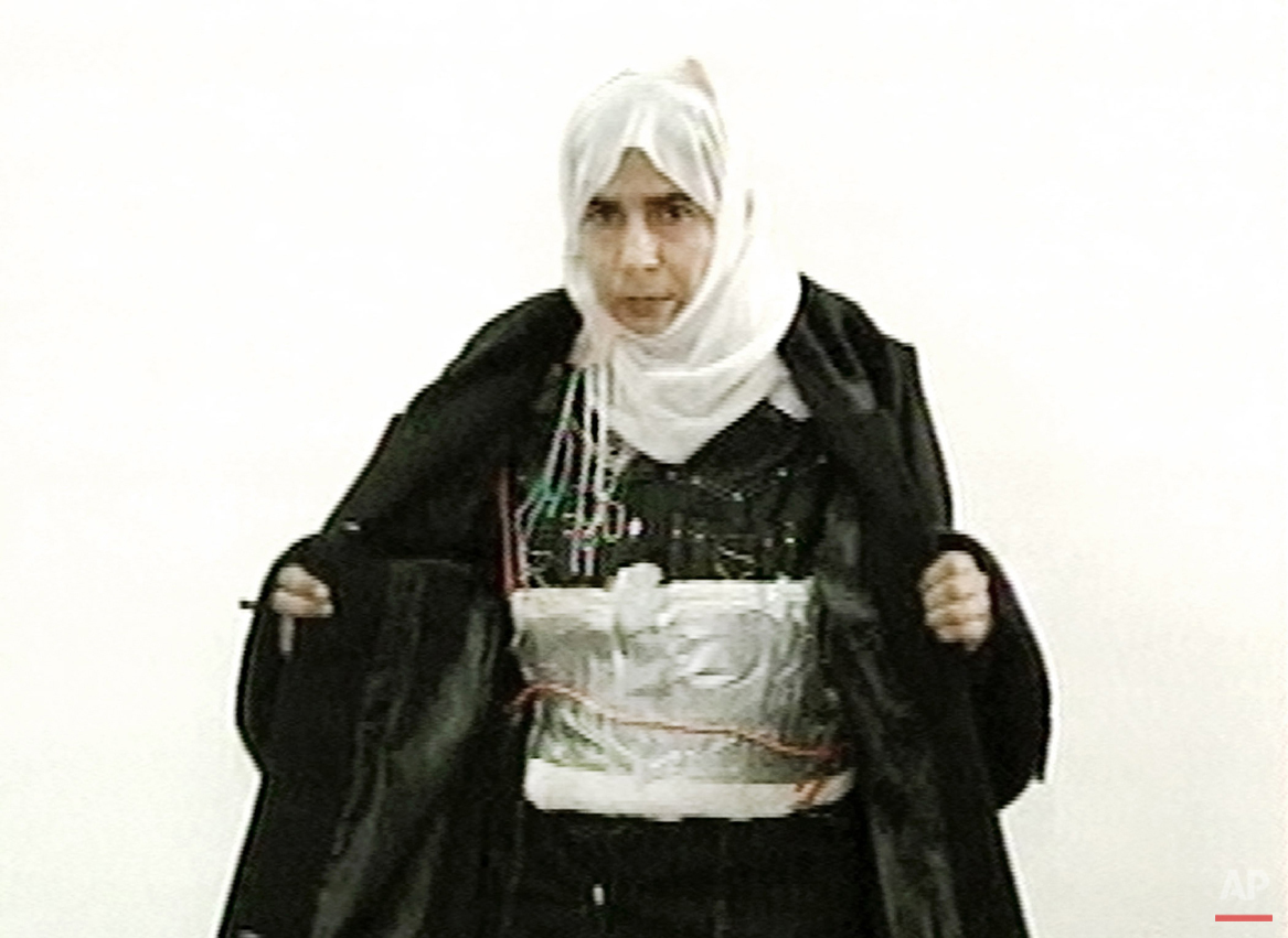This image made from television on Sunday Nov. 13, 2005 shows Iraqi Sajida Mubarek Atrous al-Rishawi opening her jacket and showing an explosive belt as she confesses on Jordanian state-run television to her failed bid to set off an explosives belt inside one of the three Amman hotels targeted by al-Qaida in Jordan. While most suicide bombers are men, Islamic militant groups have occasionally deployed women to carry out such attacks. Long before the rise of Islamic radicalism, women suicide bombers were used by leftist and separatist groups in the Arab and beyond. (Jordanian TV via AP)