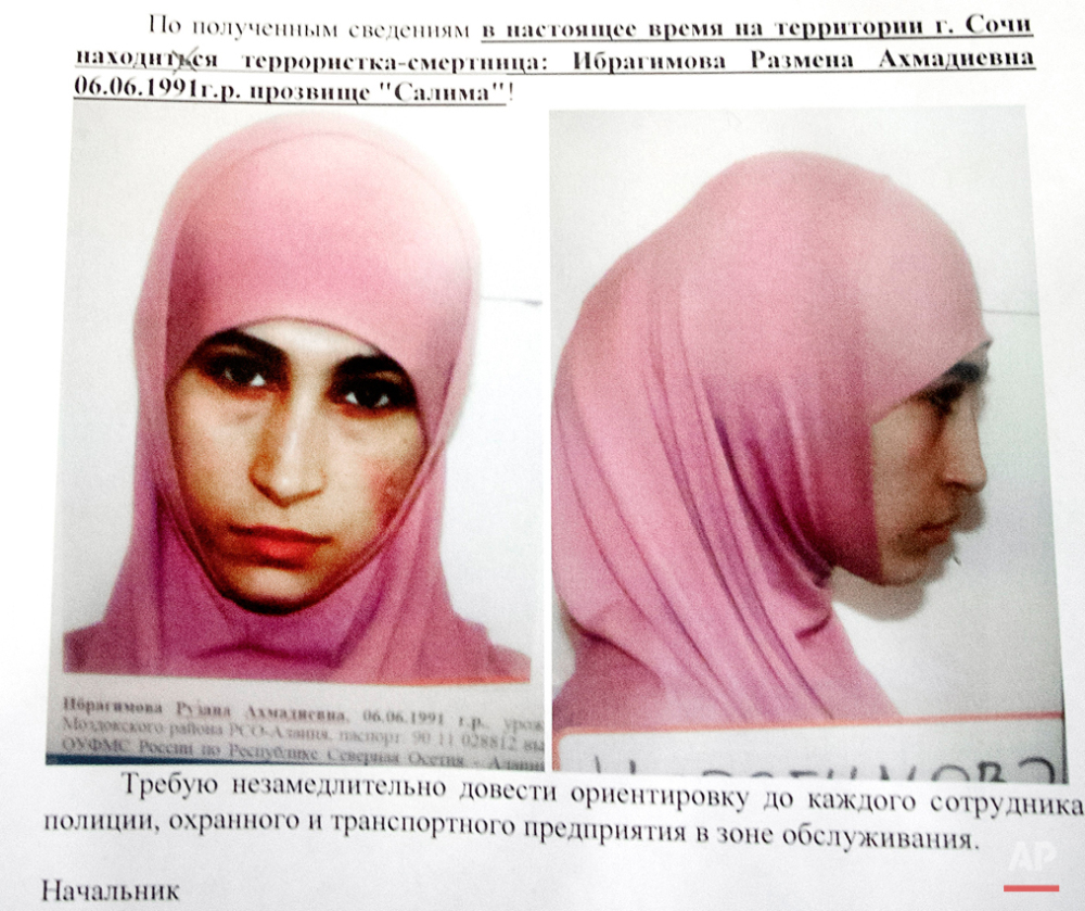 This Tuesday, Jan. 21, 2014 photo shows a police leaflet showing Ruzanna Ibragimova and contains warnings about three potential suicide bombers including Ibragimova, at a hotel in Sochi. While most suicide bombers are men, Islamic militant groups have occasionally deployed women to carry out such attacks. Long before the rise of Islamic radicalism, women suicide bombers were used by leftist and separatist groups in the Arab and beyond. (AP Photo/Nataliya Vasilyeva)