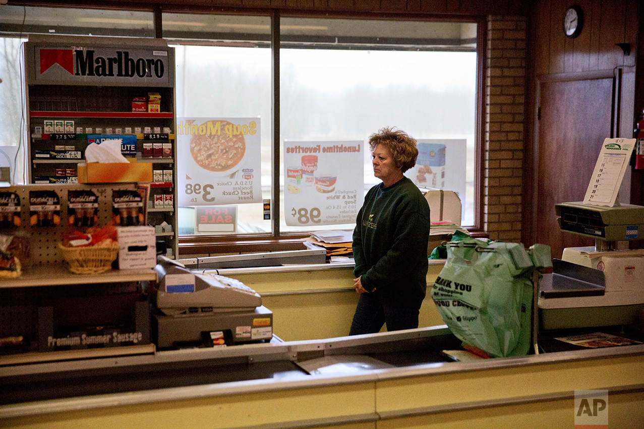 Mary Stuckey, who owns the only market in town with her husband, waits for customers in Wauzeka, Wis., Friday, Jan. 20, 2017. The mom-and-pop grocery store has been a fixture in the community for more than 100 years. But the owners - who hope to retire and have had the store on the real estate market for a few years with no takers - say business has slowed, partly because residents are willing to travel longer distances to shop at grocery and big box stores in Prairie du Chien. (AP Photo/David Goldman)