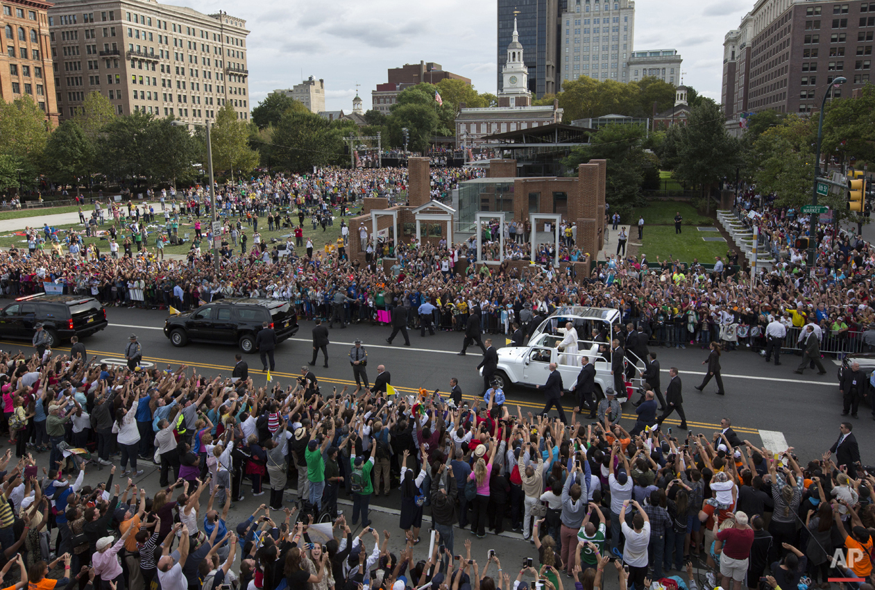 Pope Francis passes the crowd in his pope mobile on Independence Mall in Philadelphia on Saturday, Sept. 26, 2015. The pope spoke at Independence Hall on his first visit to the United States. (AP Photo/Laurence Kesterson, Pool)