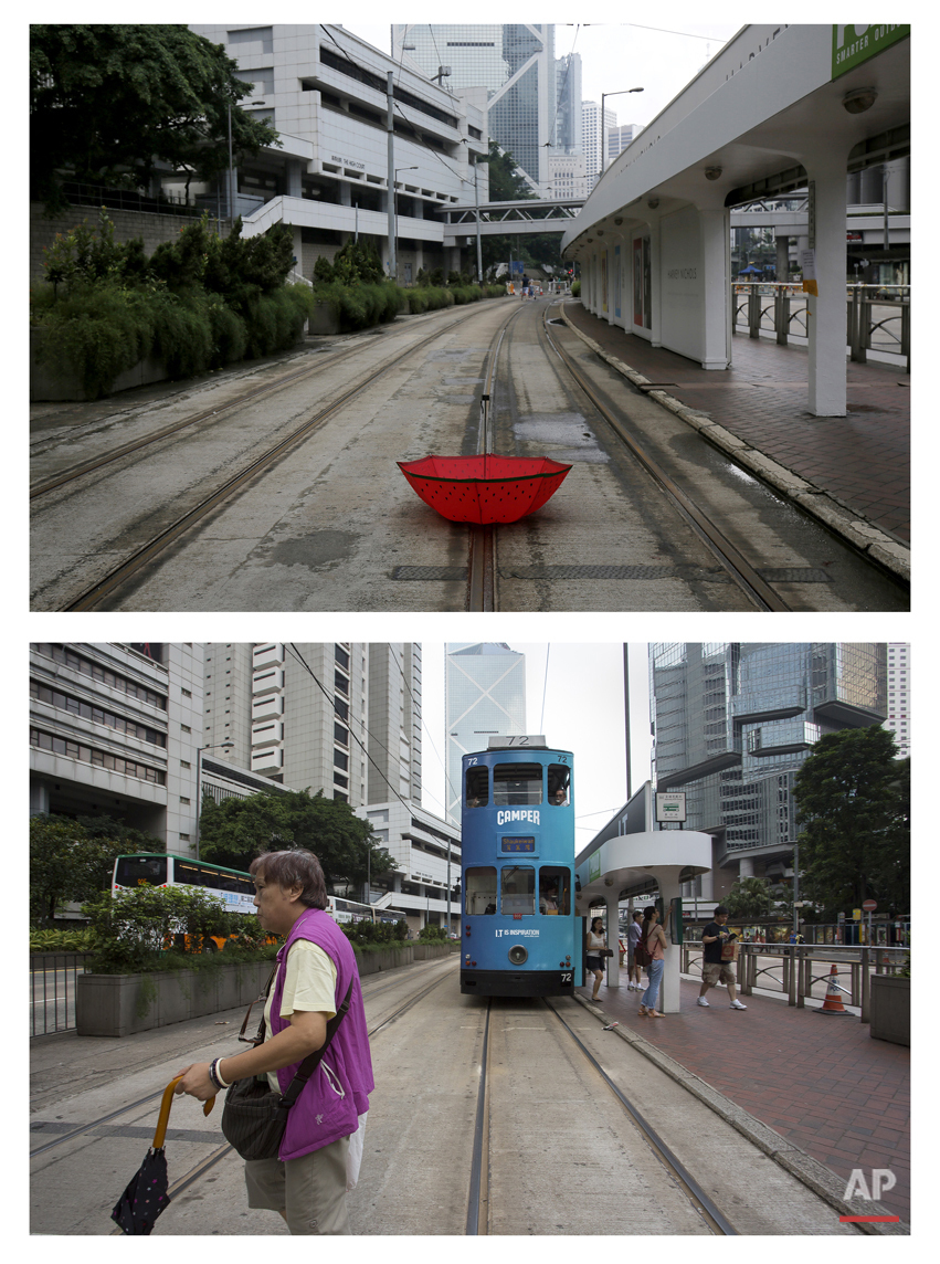 This combination of Oct. 4, 2014 file and Sept. 26, 2015 photos shows an umbrella sitting on a deserted tram track upside down at a rally outside the government headquarters during the Umbrella Movement in Hong Kong and a woman walking past a tram at the same area. (AP Photo/Vincent Yu, File)