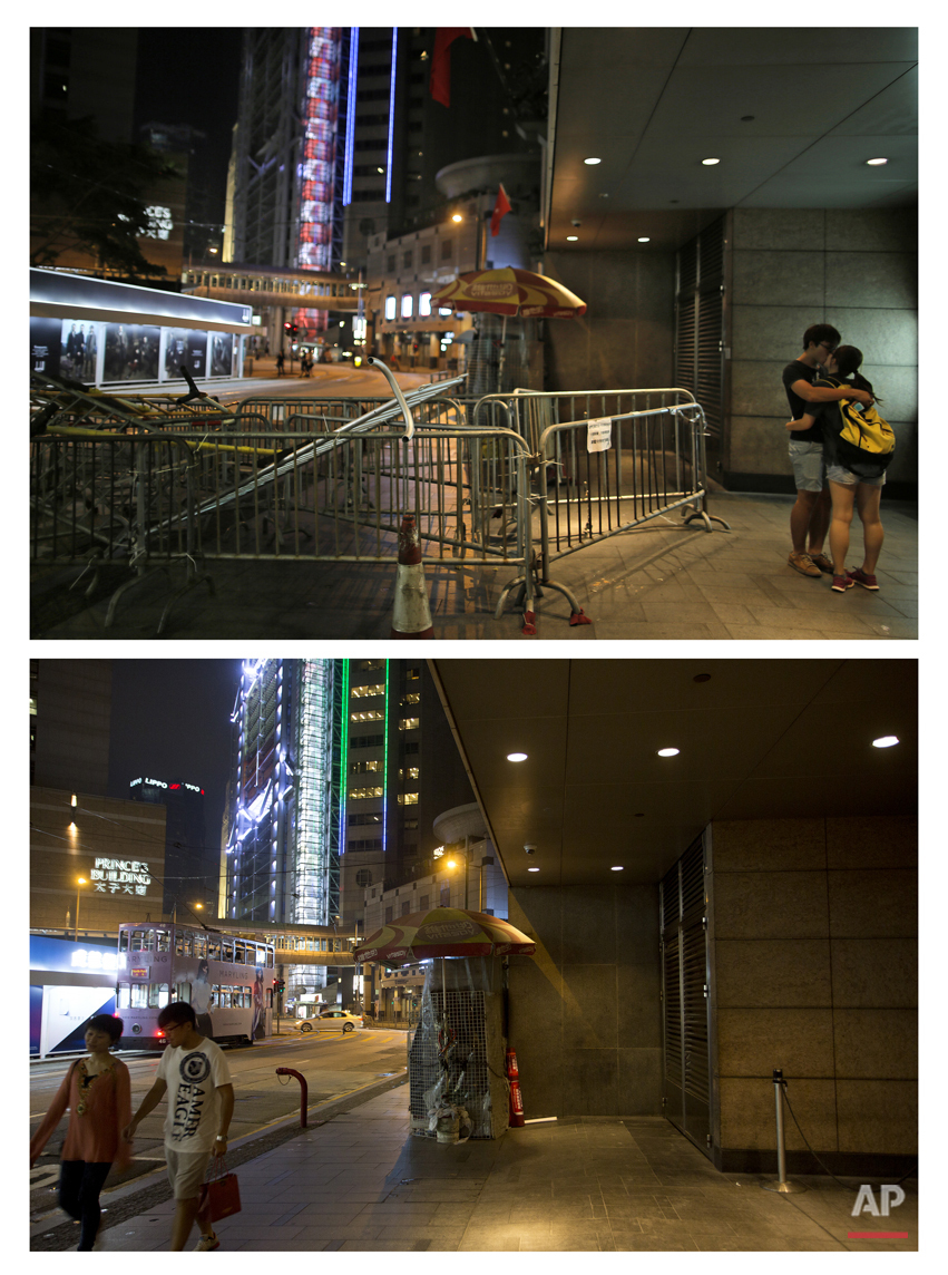This combination of Oct. 1, 2014 file, top, and Sept. 26, 2015 photos shows two students kissing next to barricades in the central business district during the Umbrella Movement in Hong Kong, and a couple walking past the same place almost a year later. city.(AP Photo/Vincent Yu, File)