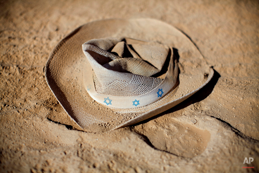 In this photo taken Friday, June 6, 2014, a hat with stars of david lays on the ground during Israelís first Midburn festival, modeled after the popular Burning Man festival held annually in the Black Rock Desert of Nevada, in the desert near the Israeli kibbutz of Sde Boker. The festival took place a few miles southwest of the desert gravesite of Israelís founding father, David Ben-Gurion, who dreamed of making the Negev desert bloom _ though he probably didnít envisioned it blossoming with hula hoops and pyrotechnics. At the end, participants were told to remove their own trash and leave the desert without a trace. (AP Photo/Oded Balilty)