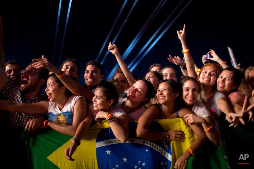 Fans watch the 'Tribute to Cazuza' show during the Rock in Rio music festival in Rio de Janeiro, Brazil, Friday, Sept. 13, 2013. (AP Photo/Felipe Dana)
