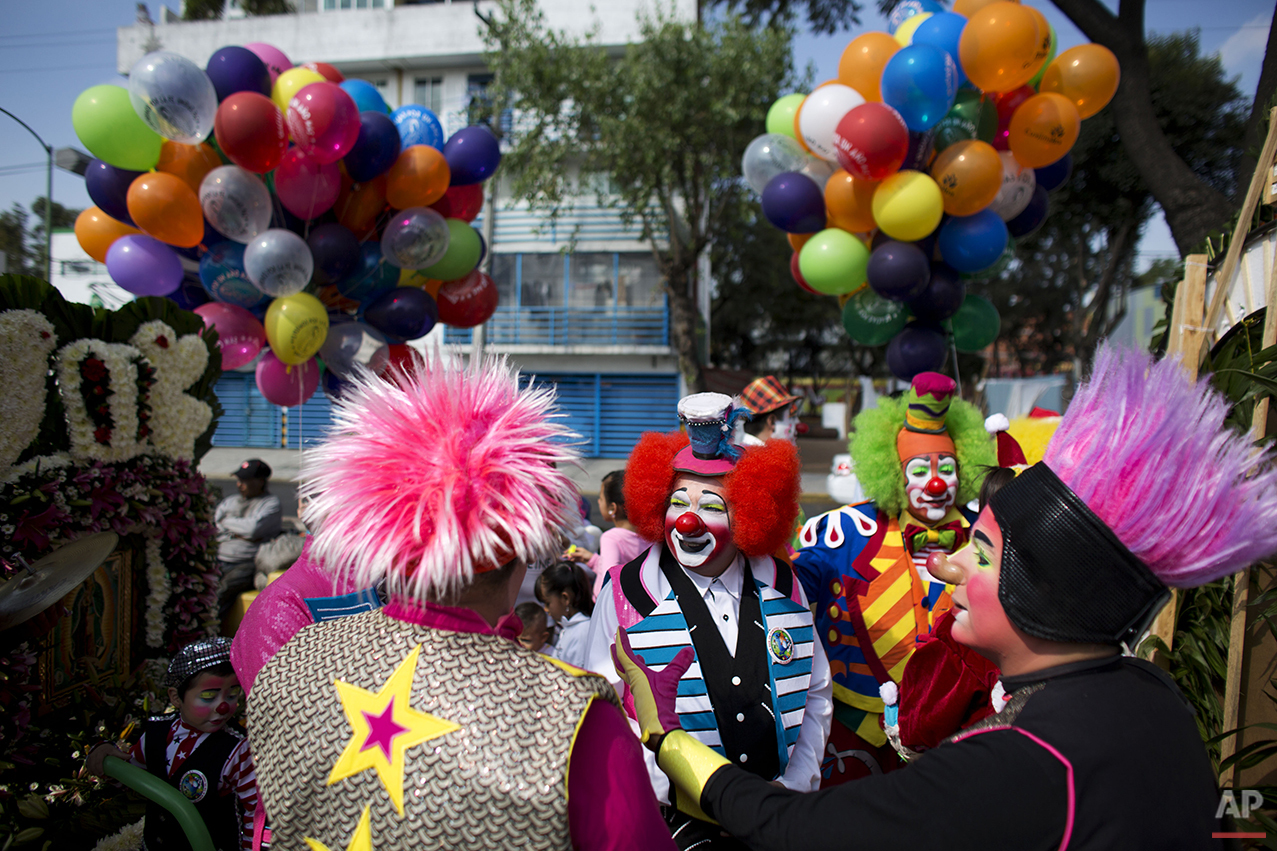 Clowns gather for a procession toward the Basilica of Our Lady of Guadalupe in Mexico City, Monday, Dec. 14, 2015. Hundreds of clowns belonging to various clown associations made their annual pilgrimage to the Basilica on Monday to pay their respects to the Virgin of Guadalupe, Mexico's patron saint. (AP Photo/Rebecca Blackwell)