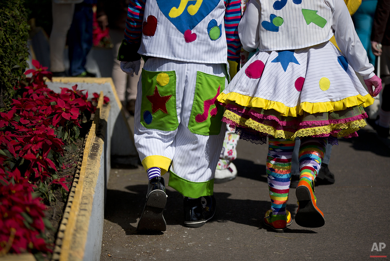 Clowns march together toward the Basilica of Our Lady of Guadalupe in Mexico City, Monday, Dec. 14, 2015. Hundreds of clowns belonging to various clown associations made their annual pilgrimage to the Basilica on Monday to pay their respects to the Virgin of Guadalupe, Mexico's patron saint. (AP Photo/Rebecca Blackwell)