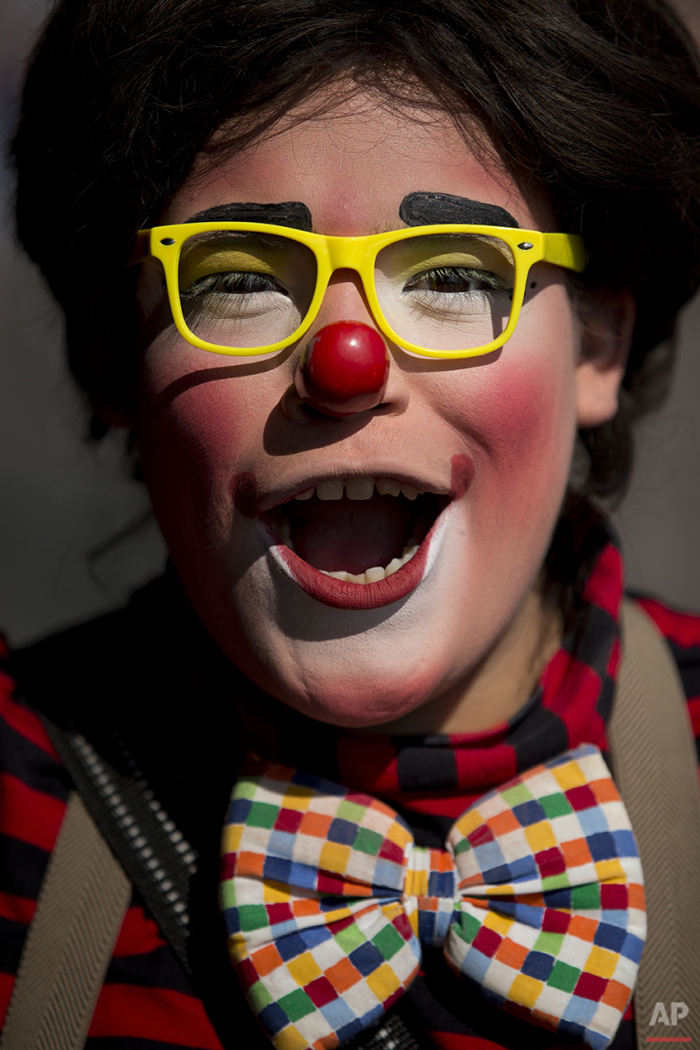 A clown poses for a portrait outside the Basilica of Our Lady of Guadalupe in Mexico City, Monday, Dec. 14, 2015. Hundreds of clowns belonging to various clown associations made their annual pilgrimage to the Basilica on Monday to pay their respects to the Virgin of Guadalupe, Mexico's patron saint. (AP Photo/Rebecca Blackwell)