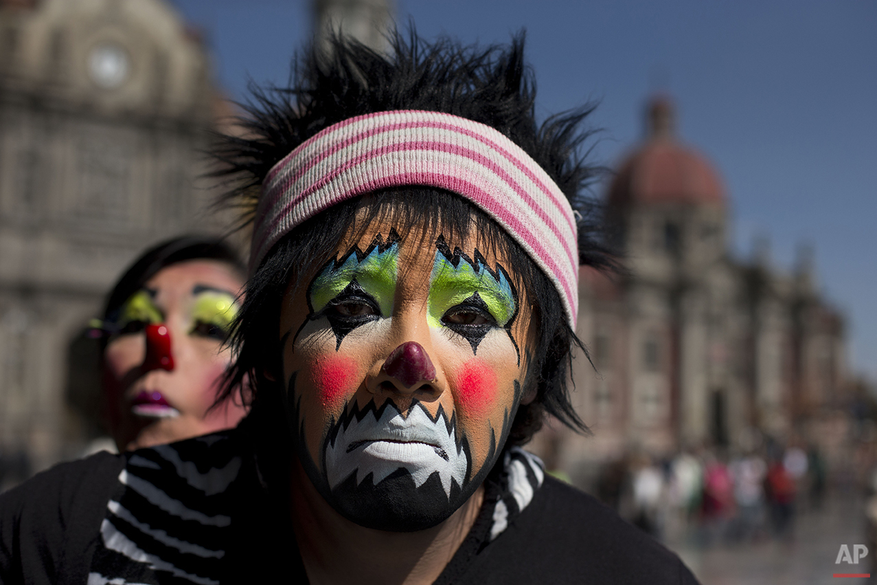 Clowns pose for a picture outside the Basilica of Our Lady of Guadalupe in Mexico City, Monday, Dec. 14, 2015. Hundreds of clowns belonging to various clown associations made their annual pilgrimage to the Basilica on Monday to pay their respects to the Virgin of Guadalupe, Mexico's patron saint. (AP Photo/Rebecca Blackwell)