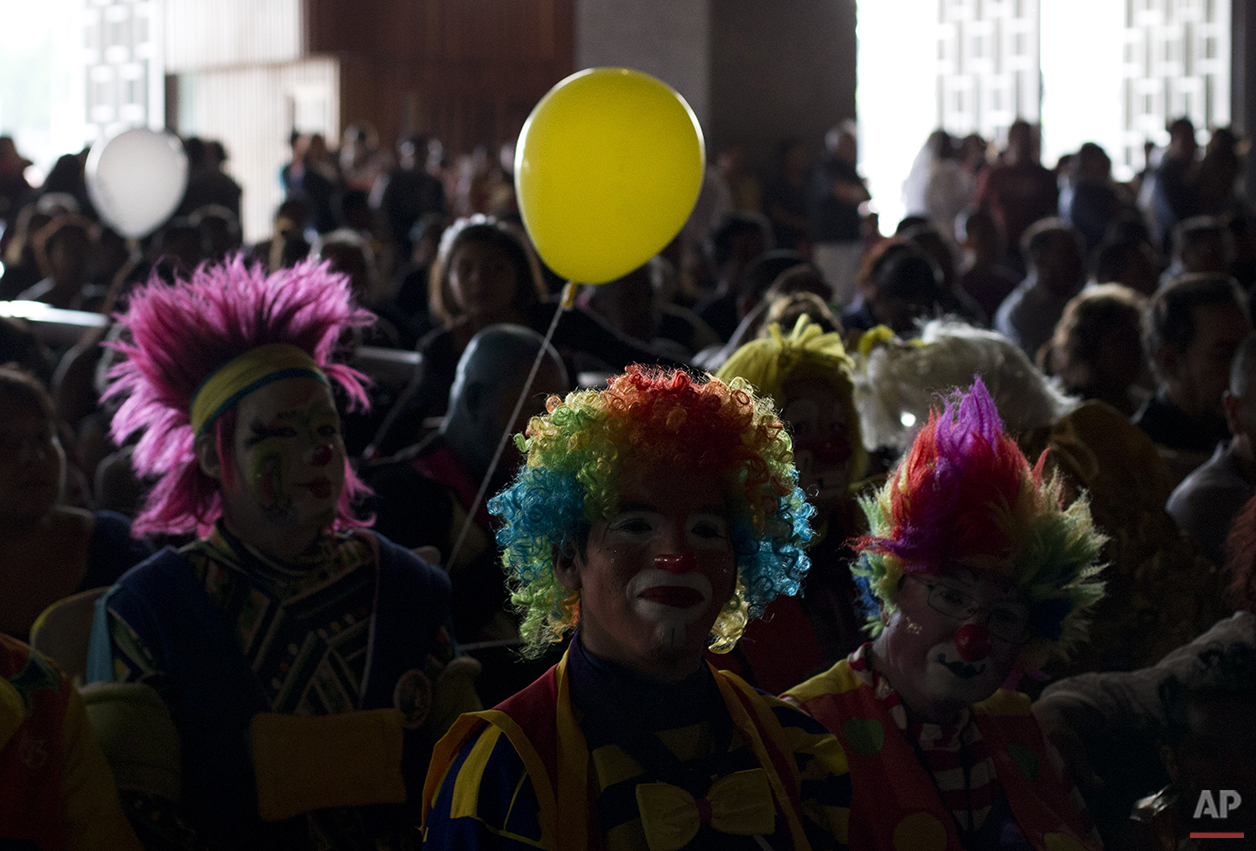 Clowns attend a mass inside the Basilica of Our Lady of Guadalupe in Mexico City, Monday, Dec. 14, 2015. Hundreds of clowns belonging to various clown associations made their annual pilgrimage to the Basilica on Monday to pay their respects to the Virgin of Guadalupe, Mexico's patron saint. (AP Photo/Rebecca Blackwell)