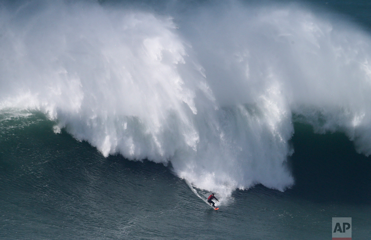 Rafael Tapia, from Chile, drops down a wave during a big wave surfing session at the Praia do Norte, or North beach, in Nazare, Portugal, Friday, Feb. 10, 2017. (AP Photo/Armando Franca)