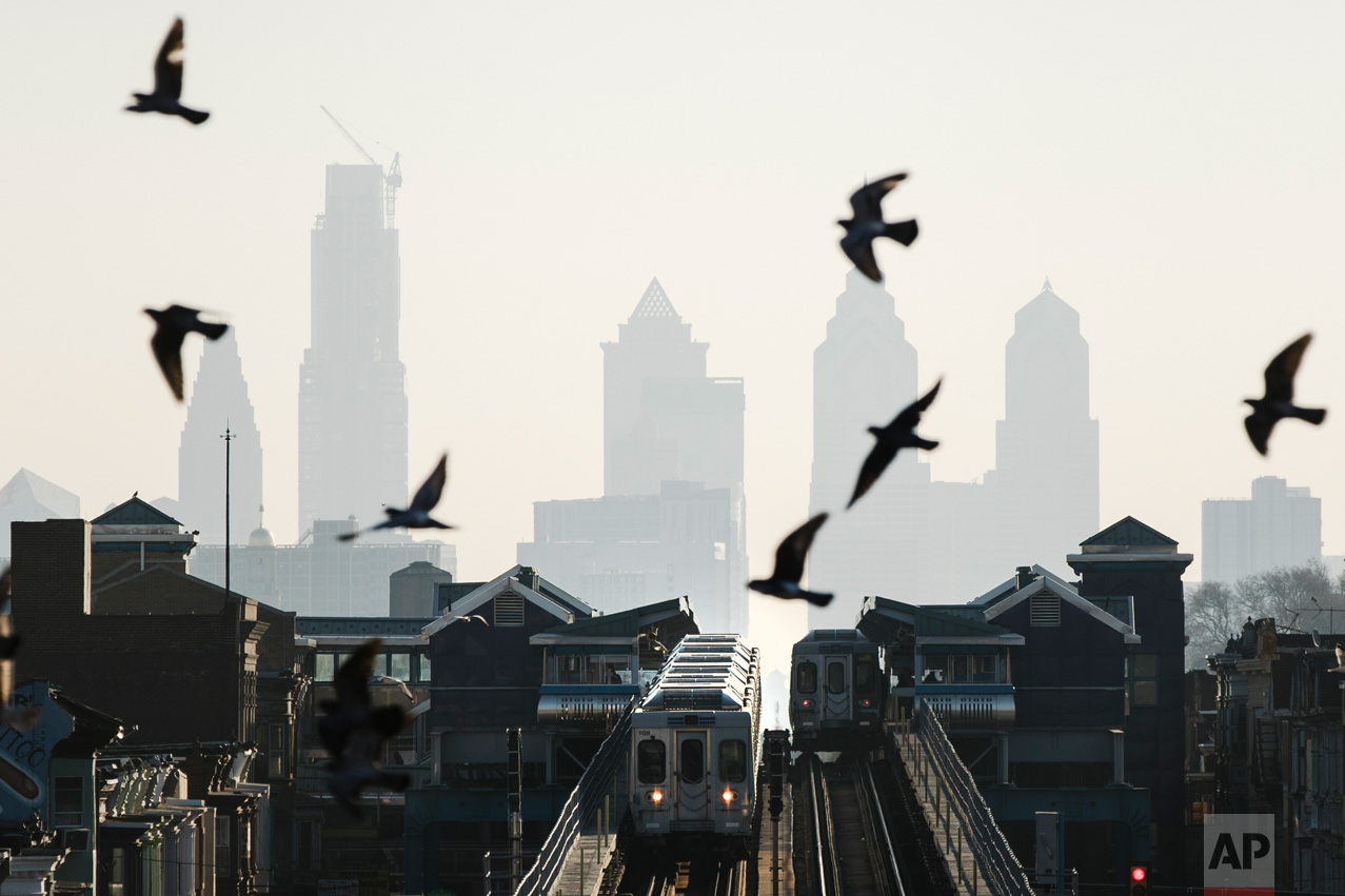 Birds fly over trains along the Market-Frankford Line in Philadelphia, Monday, Feb. 6, 2017. The Southeastern Pennsylvania Transportation Authority took cars out for inspection after a crack was found on a main load-carrying beam on a Market-Frankford Line car during regularly scheduled vehicle overhaul work. (AP Photo/Matt Rourke)