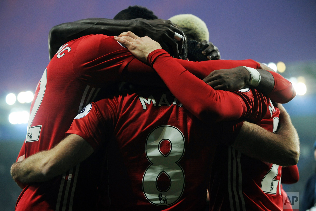 Manchester United's players celebrate after Juan Mata, center, scored the team's third goal during the English Premier League soccer match between Leicester City and Manchester United at the King Power Stadium in Leicester, England, Sunday, Feb. 5, 2017. (AP Photo/Rui Vieira)