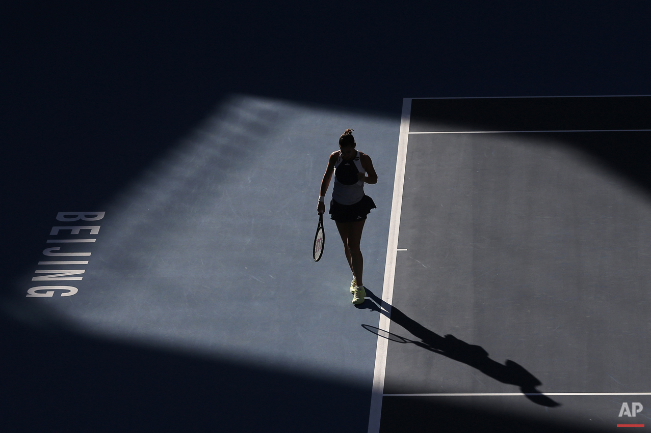 Flavia Pennetta of Italy reacts after missing a point to Anastasia Pavlyuchenkova of Russia during their women's singles match of the China Open tennis tournament at the National Tennis Stadium in Beijing, Thursday, Oct. 8, 2015. (AP Photo/Andy Wong)
