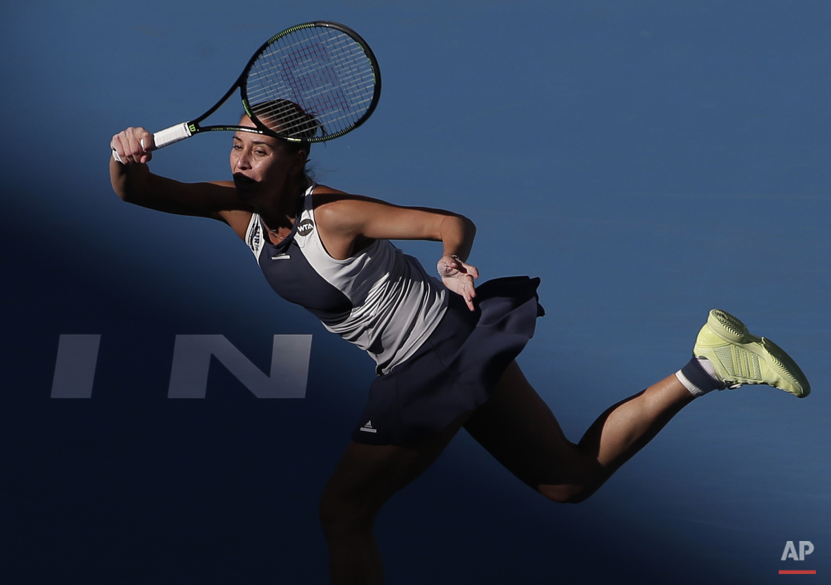 Flavia Pennetta of Italy hits a return shot against Anastasia Pavlyuchenkova of Russia during their women's singles match of the China Open tennis tournament at the National Tennis Stadium in Beijing, Thursday, Oct. 8, 2015. (AP Photo/Andy Wong)