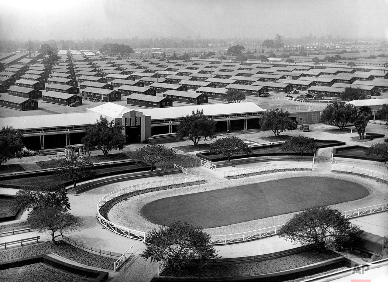 The Santa Anita Park race track is converted into an internment for evacuated Japanese Americans who will occupy the barracks erected in background in Arcadia, Ca., April 3, 1942 during World War II.  (AP Photo)