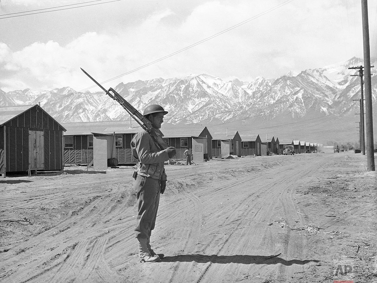 An American soldier guards a Japanese internment camp at Manzanar, Calif., May 23, 1943. (AP Photo)