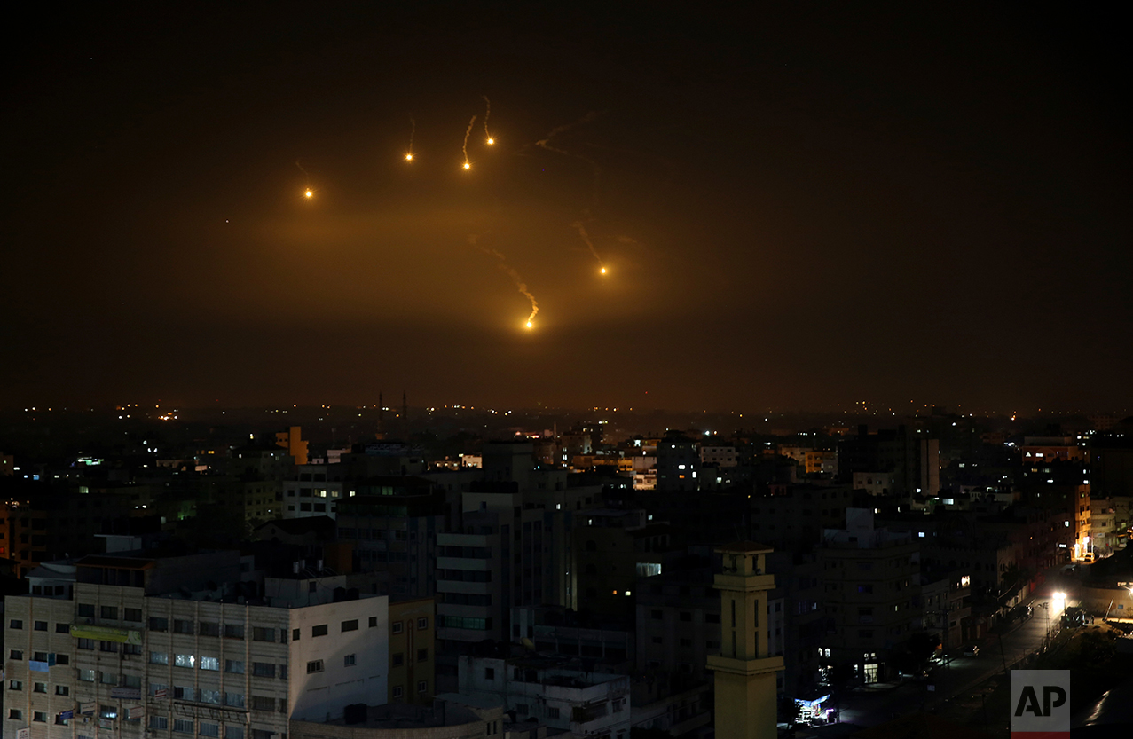Israeli forces' flares light up the night sky of Gaza City, Monday, Feb. 6, 2017. Israel's military fired on Hamas installations in Gaza after a rocket launched from the territory exploded inside Israel on Monday, with no reports of casualties on either side. Israel holds Hamas responsible for all incoming fire. (AP Photo/Adel Hana)