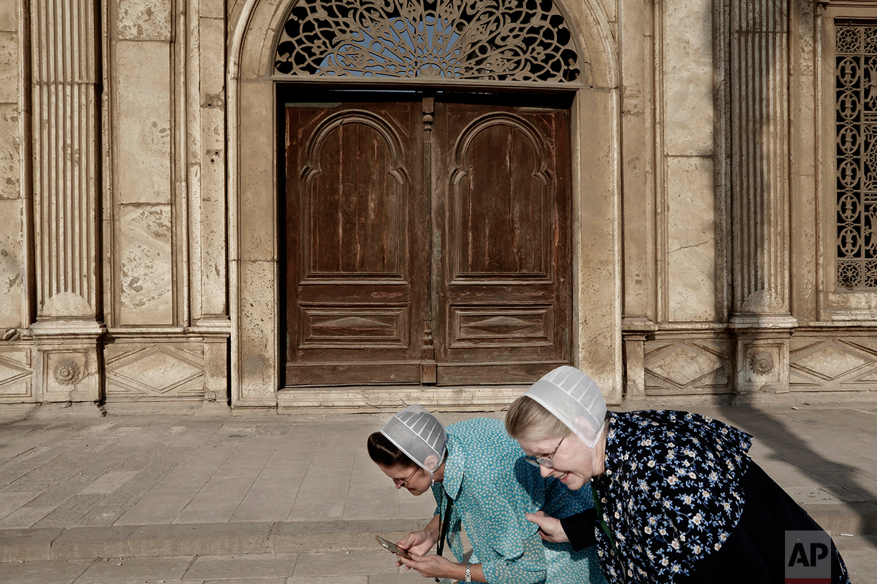 American tourists from Washington laugh as they visit the Citadel of Salah al-Din, a preserved medieval site, and one of the most important landmarks in Cairo, Egypt, Sunday, Feb. 19, 2017. (AP Photo/Nariman El-Mofty)