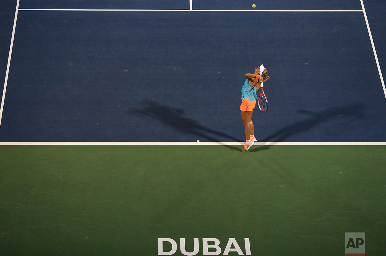 Angelique Kerber of Germany serves the ball to Elina Svitolina of Ukraine during a semi final match of the Dubai Tennis Championships in Dubai, United Arab Emirates, Friday, Feb. 24, 2017. (AP Photo/Kamran Jebreili)