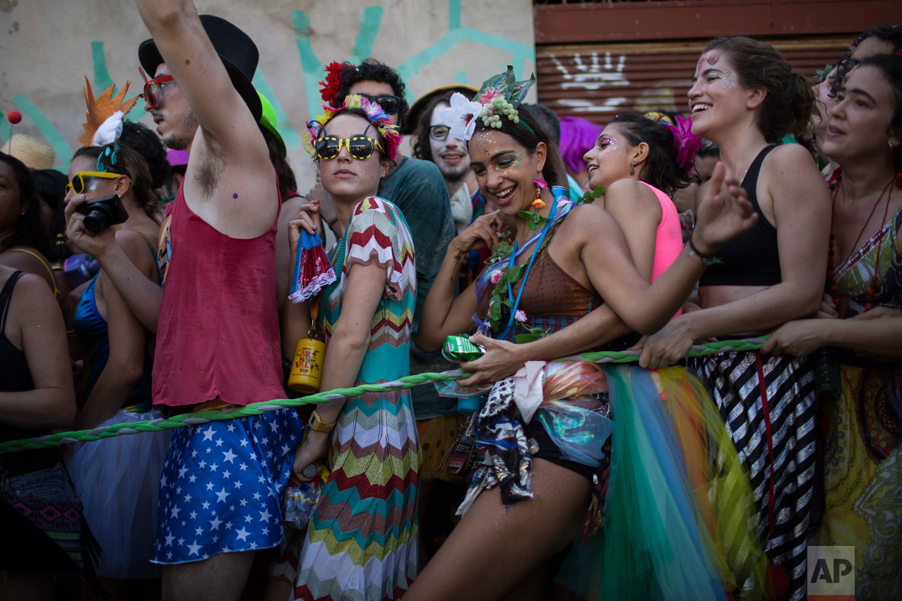 "Revelers attend the Ceu na Terra, or 'Heaven on Earth' carnival street party in Rio de Janeiro, Brazil, Saturday, Feb. 18, 2017. Merrymakers take to the streets in hundreds of open-air ""bloco"" parties ahead of Rio's over-the-top Carnival, the highlight of the year for many. (AP Photo/Felipe Dana)"