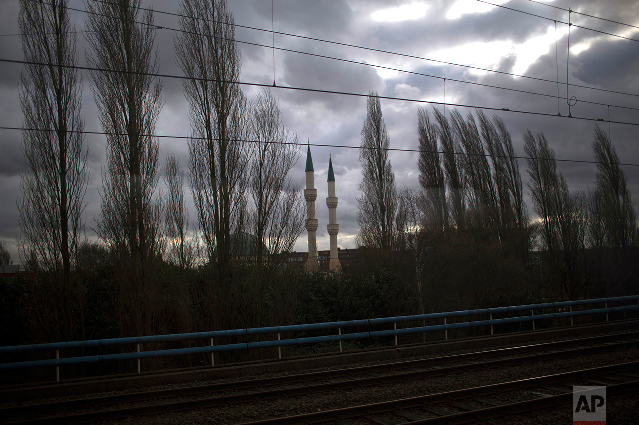 In this Thursday, March 2, 2017 photo, a mosque is seen on the outskirts of The Hague, The Netherlands. Of The Netherlands' 17 million people, just over one in five now have a foreign background. That number rises to roughly half-and-half in the four largest melting-pot cities: Amsterdam, Rotterdam, Utrecht and The Hague. About 5 percent of the population, at least 850,000 people, is Muslim. (AP Photo/Emilio Morenatti)