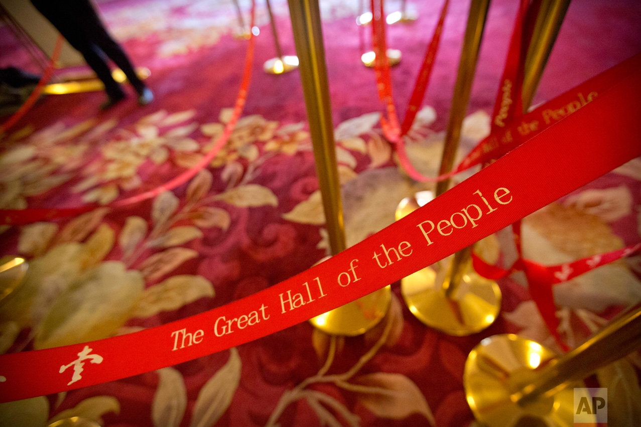 In this Wednesday, March 8, 2017 photo, a man stands near rope lines used to line up journalists during a plenary session of China's National People's Congress (NPC) at the Great Hall of the People in Beijing. (AP Photo/Mark Schiefelbein)