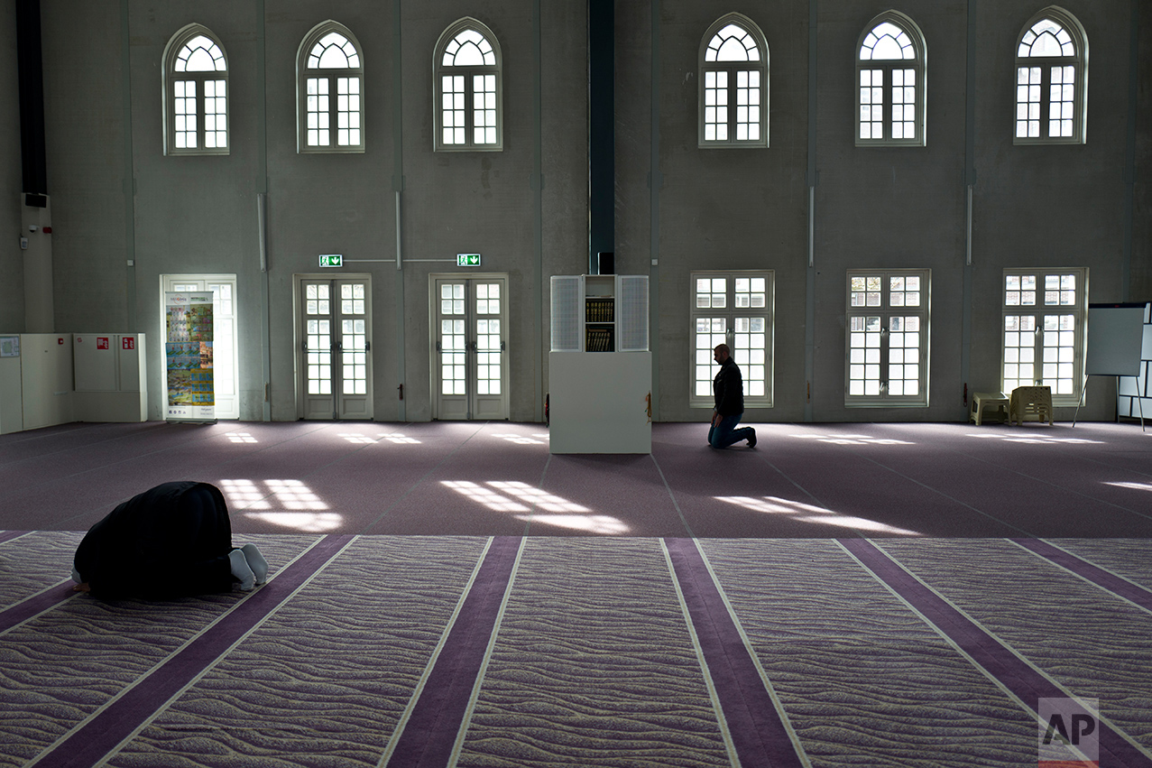 Muslim men pray in a mosque in Amsterdam, Netherlands, Monday, March 13, 2017. (AP Photo/Muhammed Muheisen)