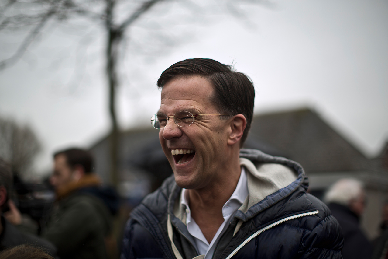 Dutch Prime Minister Mark Rutte, laughs while talking to supporters during an election event in Wormerveer, Netherlands, Saturday, Feb. 25, 2017.  (AP Photo/Muhammed Muheisen)
