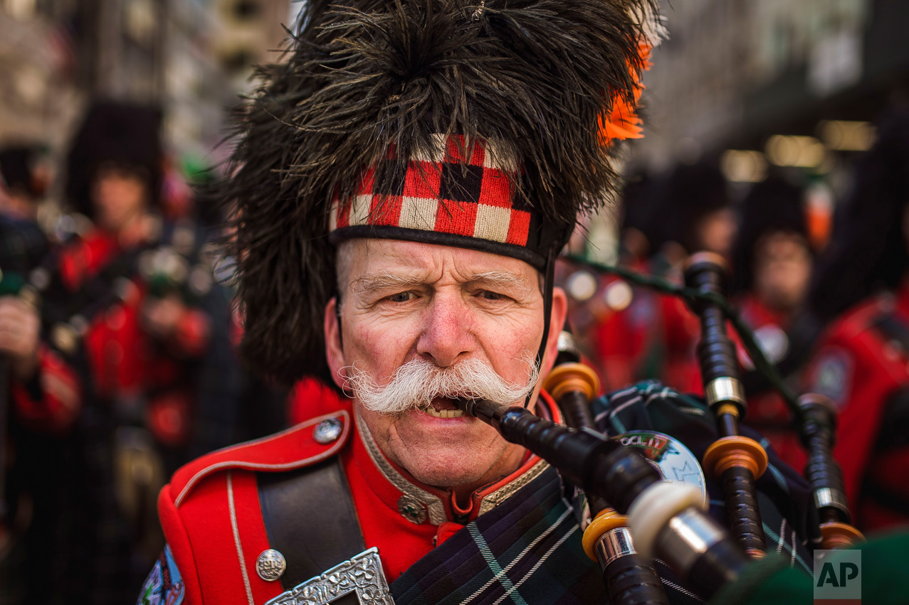 Bagpipers march up Fifth Avenue during the St. Patrick's Day Parade in New York on Friday, March 17, 2017. (AP Photo/Andres Kudacki)