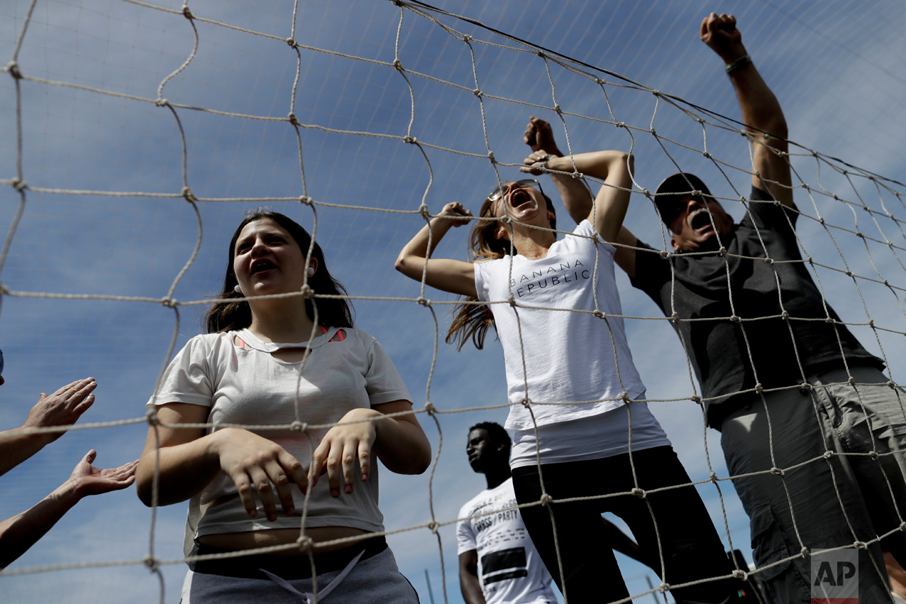 In this Nov. 19, 2016 photo, parents scream as children play soccer at a youth league game on the outskirts of in Buenos Aires, Argentina. Some parents cheered as if they were witnessing the World Cup final as a coach barked orders at their kids on the sideline. (AP Photo/Natacha Pisarenko)