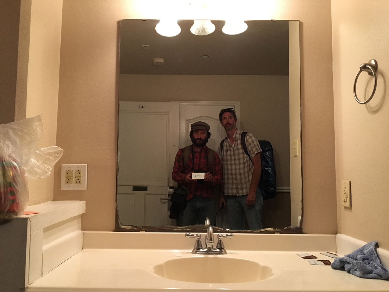 AP photographer Rodrigo Abd, left, and writer Christopher Sherman pose for a selfie inside their hotel room, March 24, 2017, Laredo, Texas. (AP Photo/Rodrigo Abd)